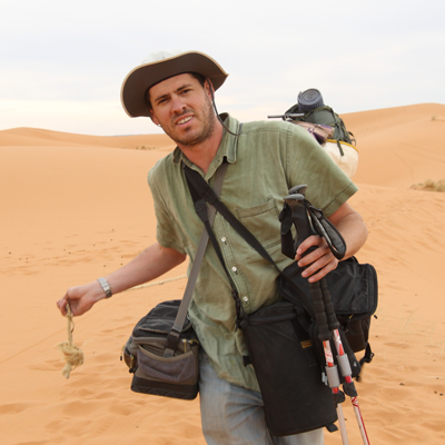 Author / Photographer Ed Darack deep in the interior of the Sahara Desert of North Africa during a photography expedition during which he conducted research on his forthcoming novel series. Copyright Ed Darack; Permission granted for use in media products about / related to Ed Darack's creative work. width=