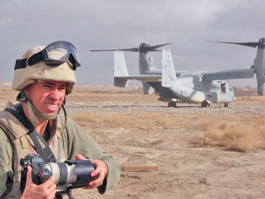 Author / Photographer Ed Darack preparing to board a just-landed Marine Corps MV-22 Osprey at the end of a combat operation on which he embedded in Afghanistan's southern Helmand Province. Copyright Ed Darack; Permission granted for use in media products about / related to Ed Darack's creative work. width=